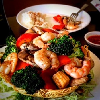 Chinese Food Prawn and Vegetables in a Noodle Nest from the Mekong Restaurant